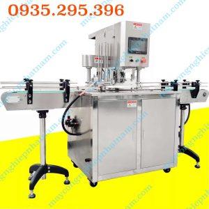 Máy viền mí lon tự động (NNDC - E04) dùng để viền mí lon các loại lon, hũ nhựa, nhôm trong ngành thực phẩm, hóa chất