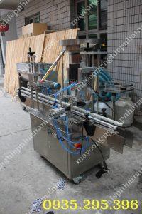 Máy đóng nắp chai tự động QDX-1 (NNDC - C05) Chuyên dùng để đóng các loại nắp trơn có ren trong ngành thực phẩm, mỹ phẩm, dược phẩm...