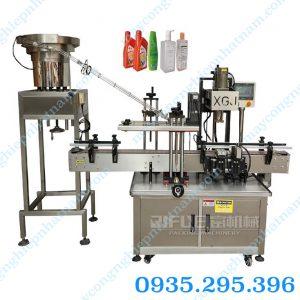 Máy xoáy nắp chai tự động XGJ-1 (NNDC - B12)có thể đóng được tất cả các loại nắp chai dùng trong ngành thực phẩm, mỹ phẩm, hóa chất...