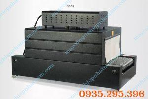 Máy co màng băng tải dạng lưới 400 x 200 (NNCM-A05)dùng để co màng, bọc màng các loại log chai, các loại hộp, sách vở...  – Băng tải lưới phẳng tránh đổ sản phẩm,